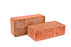 Two red decorative pavement bricks Royalty Free Stock Photo