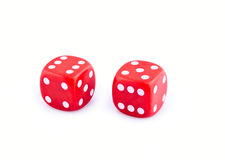 Two red dice. Isolated on white background royalty free stock image