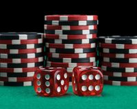 Two red dice on the background of the poker game royalty free stock photo