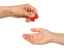 Two red dice being given Stock Photography