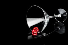 Two red dice in a cocktail glass Royalty Free Stock Photos