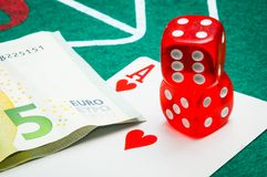 Two red dice with euros Stock Image