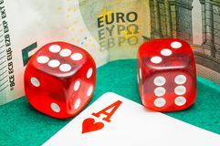 Two red dice with euros Royalty Free Stock Photo