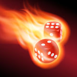 Two red dice in fire. Stock Image