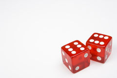 Two Red Dice on Light Background Royalty Free Stock Images