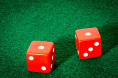 Two Red Dice on Poker Table Royalty Free Stock Photos