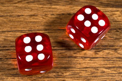 Two Red Dice on a Table Stock Image