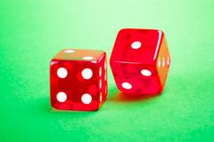 Two red dices Stock Photos