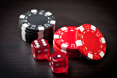 Two red dices and black and red chips Royalty Free Stock Images