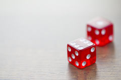 Two Red Dices Isolated on Desktop Royalty Free Stock Image