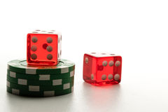 Two Red dices and poker chips Royalty Free Stock Photos