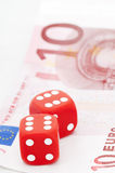 Two red dices on ten euro bill Stock Photos