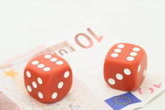 Two red dices on ten euro bill Royalty Free Stock Photos