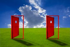 Two Red door placed on an outdoor lawn with blue sky floor. Concepts, ideas, choices, and business decisions royalty free illustration