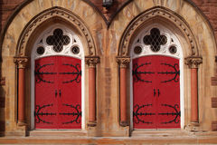 Two Red Doors. To a church royalty free stock photos