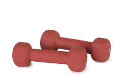 Two red dumbbells Stock Photos