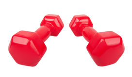 Two red dumbbells Royalty Free Stock Photos