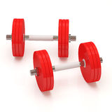 Two Red Dumbbells On White Background Royalty Free Stock Photography