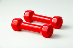 Two red dumbbells. On white background Royalty Free Stock Photo