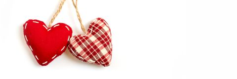 Two red fabric hearts on isolated on white panoramic background, love valentine concept. Two red fabric hearts on isolated on white panoramic background, love stock photography