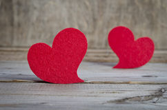 Two red fabric hearts on a wooden board Stock Photography