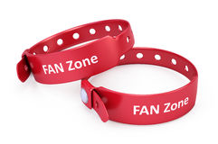 Two red fanzone bracelets. Isolated on white Royalty Free Stock Photo