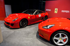 Two Red Ferrari California at the Auto Show stock photos