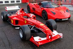 Free Two Red Ferrari Racing Sports Cars For Formula 1 And Marrusia B1 On The Street Near The Garage Box Royalty Free Stock Photography - 164601207