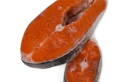 Two red fish steaks on a light background royalty free stock photo