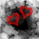 Two red flying hearts made of smoke over cloud background.  Royalty Free Stock Image