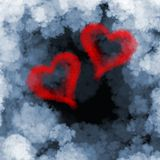 Two red flying hearts made of smoke over cloud background.  Stock Photo