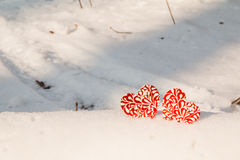 Two red frozen heart on snow Royalty Free Stock Image