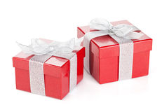 Two red gift boxes with silver ribbon and bow. Isolated on white background Royalty Free Stock Image