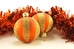 Two Red and Gold Christmas Baubles with Tinsel Stock Photo