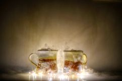Two Red and Gold Mugs and Yellow String Lights Royalty Free Stock Photos