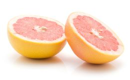 Red grapefruit isolated. Two red grapefruit halves isolated on white background cross section Stock Photography