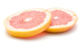 Red grapefruit isolated. Two red grapefruit ring slices isolated on white background Stock Photo