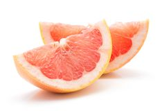 Red grapefruit isolated. Two red grapefruit slices isolated on white background Royalty Free Stock Photography