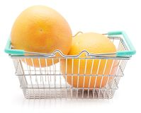 Red grapefruit isolated. Two red grapefruits in a shopping basket isolated on white background Royalty Free Stock Image