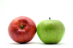 Two red and green apples. On a white background Royalty Free Stock Photos