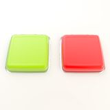 Two red and green glossy buttons over white surface Royalty Free Stock Photo