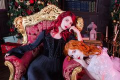 Two beautiful girls with red hair in a beautiful white wedding Victorian dresses stock photos