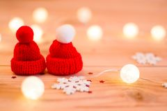 Two red hats and a snowflake. Winter royalty free stock image