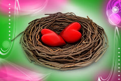 Two red heart in a bird nest Royalty Free Stock Images