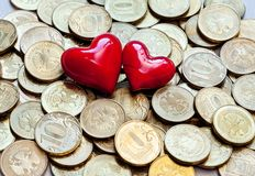 Love and coins money Royalty Free Stock Image
