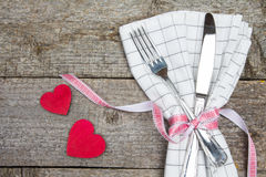 Two red heart, fork, knife and napkin on wooden table Royalty Free Stock Photography