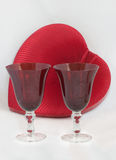 Two red heart goblets with heart box Royalty Free Stock Images