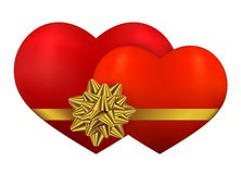 Two red heart with golden bow Royalty Free Stock Photo