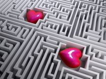 Two red heart in the labyrinth maze Stock Images