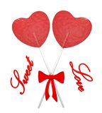 Two red heart lollipops. Two red lollipops heart shaped Royalty Free Stock Image